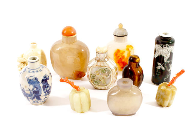 A mother o'pearl snuff bottle and stopper and nine other snuff bottles, some with stoppers,