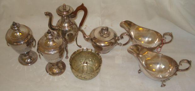 A silver plated teapot, of small size with cast vine handle, a large pair of sauce boats with beaded rims, embossed sugar basin and tongs, a pair of lidded vase shape pots and covers with mask and ring handles, and a French plate on copper, classical coffee pot with fruitwood handle.