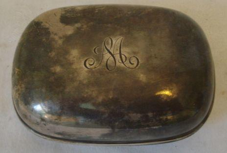 A silver soap box and cover, of plain rounded rectangular form by William Comyns 1906, 4ozs.