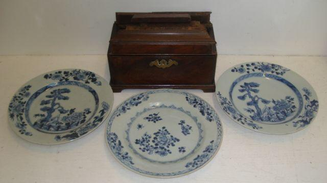 A pair of Chinese blue and white plates, Qianlong, painted with flowering trees in a fenced garden, 23cm and a similar plate and a George III rectangular mahogany tea caddy, 24.5cm. (4)