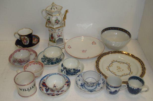 A collection of four 1st period Worcester blue and white tea bowls and saucers, a Worcester Flight & Barr trio and matching slop's bowl and a pair of similar bread and butter plates, various other 18th and early 19th Century English teawares, two Sunderland lustre child's mugs, Chinese teawares, Qianlong, Meissen floral painted cup and saucer, onion pattern tea bowl and saucer, Sevres style cup and saucer painted with floral bouquets and a Paris porcelain teapot on warmer.