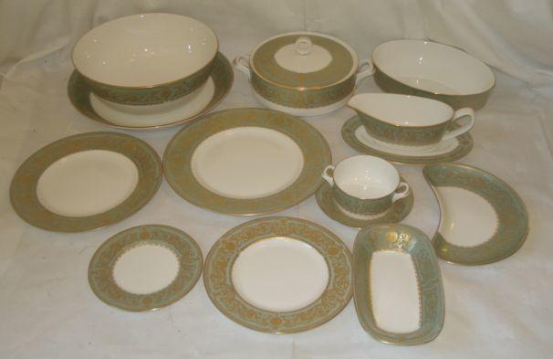 An extensive Royal Worcester 'Balmoral' dinner service, comprising 12 x 27cm dinner plates, 12 x 20cm side plates, 12 x 23.5cm supper plates, 12 x 15.5cm bread plates, 12 crescent shaped salad dishes, 12 x 10cm soup bowls on stands, 3 x 19.5cm covered tureens, 2 x sauce boats and stands, oval open bowl 23 x 16.5cm, circular bowl 25cm, shallow circular dish 29.5cm, oblong bowl 20.5 x 11.5cm, oval serving dish 33 x 28cm, oval serving dish 39 x 31cm, oval serving dish 44 x 36cm. (101 pieces)