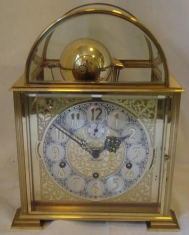 Kieninger:  a post war gilt brass cased mantle clock, the square dial with Arabic chapter and pierced spandrels, seconds subsidiary, the brass plate movement striking on 8 bells, silent, night, strike lever, also Whittington, St Michael's, Westminster chimes.