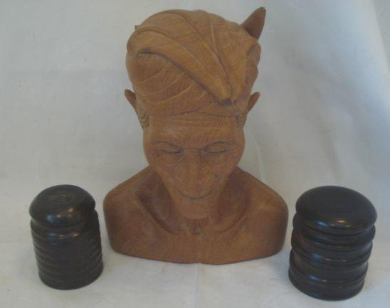 A mid 20th Century carved teak bust of an Indonesian Farmer, 30cm, labelled 'Sourabaya - Java April 1946', and two turned hardwood pots and covers. (3)