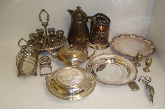 An electroplate engraved compressed circular teapot, Elkington & Co, and the following electroplate, George IV style foliate embossed hot water pot, Victorian oval six cup egg cruet, two toast racks, three entree dishes, two syphon stands, one with lion mask ring handles, soup plate, salver, cased fish eaters, candlesnuffers, snuff box, flatware and cutlery and other items.