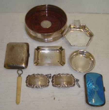 A  lady's Scandinavian silver and blue guilloche enamel cigarette case, early 20th Century, and the following silver, a George III style coaster, pair of George IV style decanter labels, small plain coaster, leafy scroll engraved cigarette case, Asprey hexagonal ashtray, and a rectangular similar, 80zs weighable, also an ivory cased steel corkscrew.