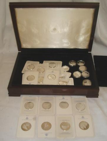 A set of forty silver medallions, by Birmingham Mint 'Ancient Counties of England' contained in a mahogany finish table top box with lift-out tray, and certificate, 52ozs total.
