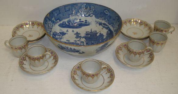 A set of six late 18th Century English porcelain coffee cups and seven matching saucers, with fluted sides, rose painted highland with gilding and an early 19th Century pearlware Willow pattern blue transfer printed bowl, rivetted. (14)