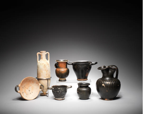 Five Greek black glazed pottery vessels and two unglazed terracotta vessels, 7