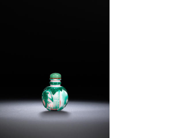 A pink and green glass overlay 'elephant' snuff bottle Qing dynasty, 1760-1830