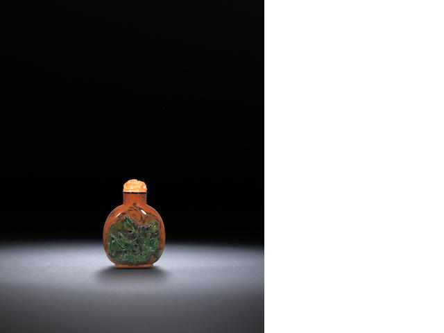 A 'wood brown' and green jasper 'grasshopper and carrot' snuff bottle Qing dynasty, 1780-1880