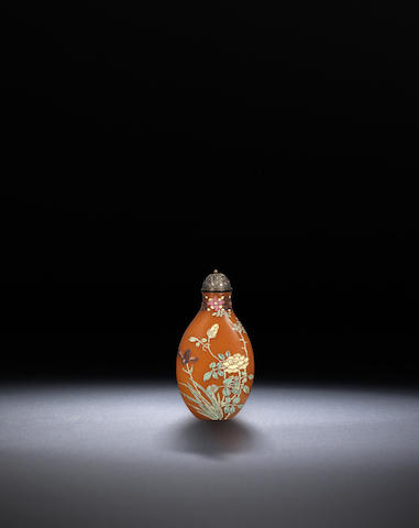 An enamel on brown glass 'flowering plants' snuff bottle Qing dynasty, Guyue xuan seal mark, circa 1770-1799