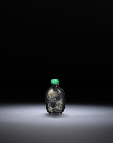 An inscribed serpentine 'archaistic' snuff bottle