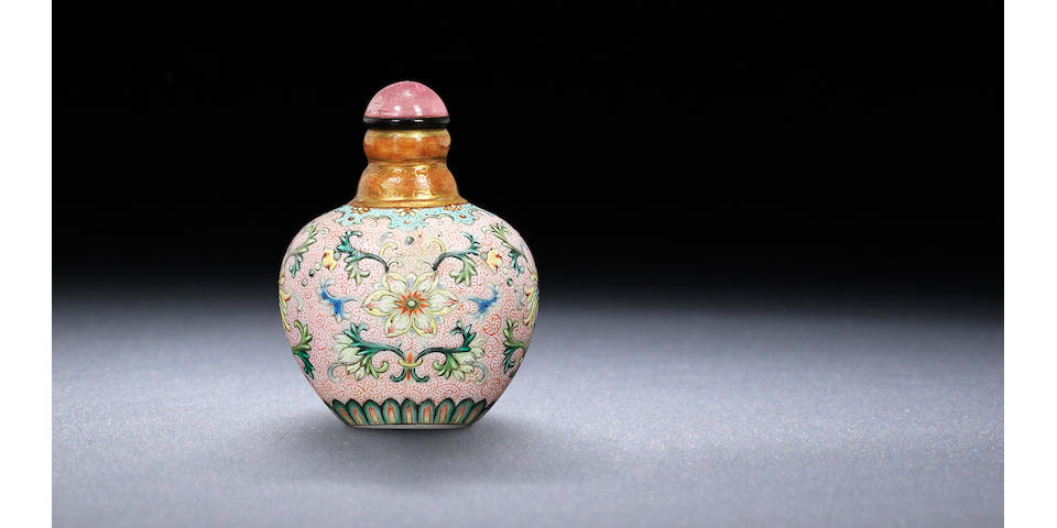 A 'famille-rose' enamel on porcelain 'lotus and chrysanthemum' snuff bottle Imperial kilns, Jingdezhen, Qianlong iron-red four-character seal mark and of the period