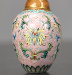 A 'famille-rose' enamel on porcelain 'lotus and chrysanthemum' snuff bottle Qianlong iron-red four-character seal mark and of the period