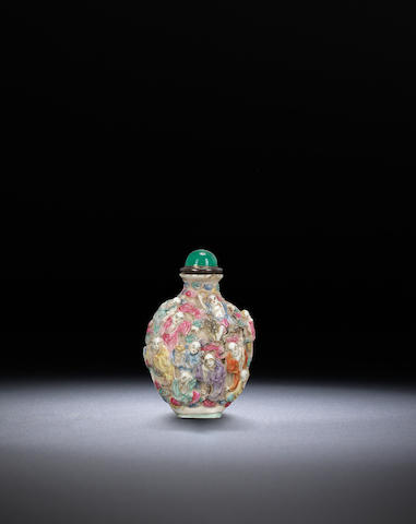 A moulded famille-rose porcelain 'eighteen luohan' snuff bottle Qianlong iron-red four-character seal mark and of the period