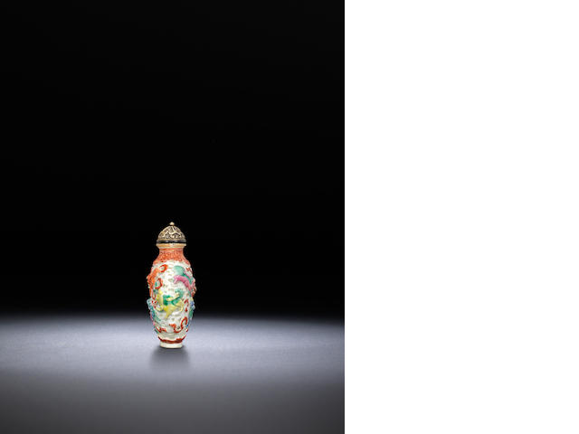 A famille-rose moulded porcelain 'lions' snuff bottle Jiaqing iron-red four-character mark and of the period