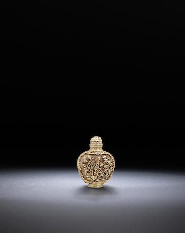 A white metal 'floral' snuff bottle 1960-1970