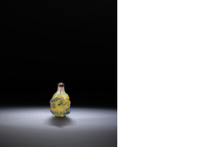 A green and yellow glass overlay 'chi dragons' snuff bottle Qing dynasty, 1750-1850