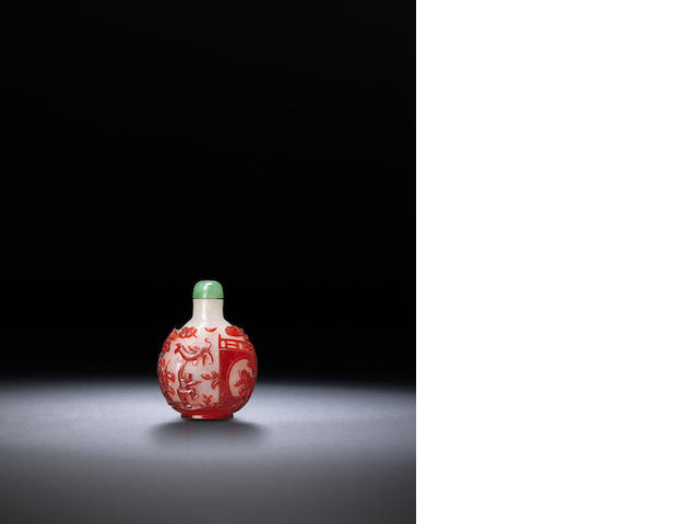A red glass overlay 'leisurely activities' snuff bottle Qing dynasty, 1750-1850