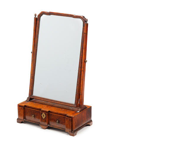 An early 18th century and later walnut and featherbanded toilet mirror