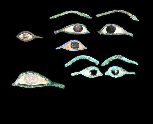 Two pairs of Egyptian bronze eye inlays and three other Egyptian eye inlays, 11