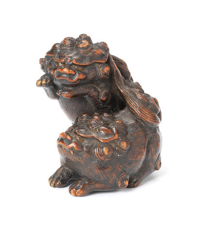 A wood netsuke of two shishi playing By Sadanobu, Tanba, early 19th century