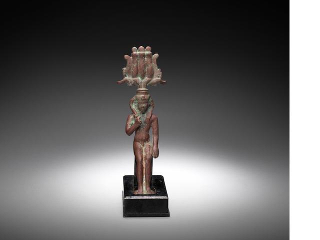 An Egyptian bronze figure of Harpokrates