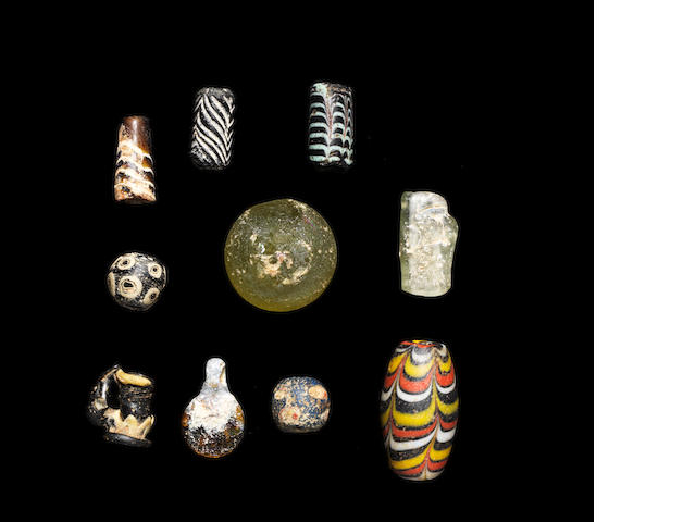 A group of ten glass beads 10