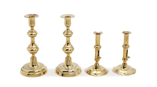 A pair of mid-18th century brass ejector candlesticks