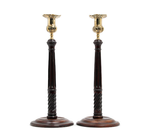 A pair of George III-style mahogany and brass candlesticks