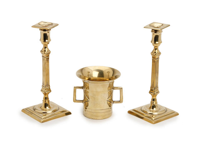 A pair of George III brass candlesticks