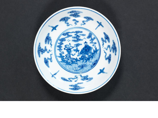 A small blue and white dish with hall mark