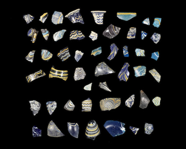 A group of core-formed glass fragments  54