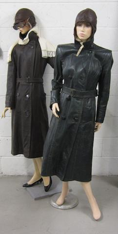 Two mannequins dressing in motoring clothing,