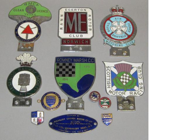 Six enamel motoring badges and six smaller badges,