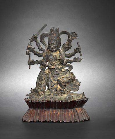A bronze figure of a seated Buddhist Deity Ming/Qing Dynasty