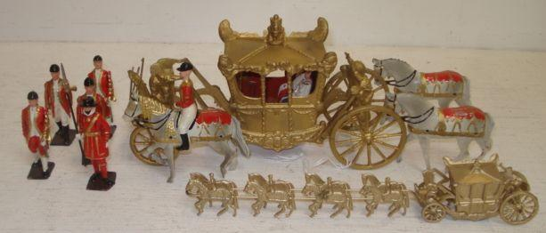 A boxed Britains Ltd model of her Majesty's State Coach, drawn by eight' Greys' and attendant figures and a Britains Ltd No. 44D boxed model of her Majesty's State Coach.
