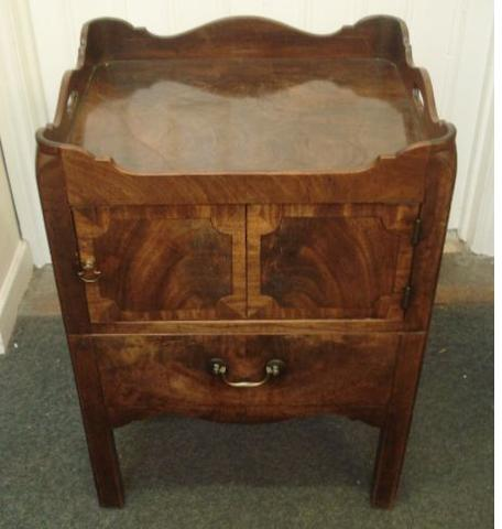 A George III mahogany tray top night commode, with cut-out carrying handles, enclosed by an ebony strung and crossbanded door a pull-out slide below, now converted to a drawer, 55cm.