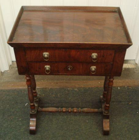 An early 19th Century mahogany and walnut tray top needlework table, restorations, fitted with two drawers, on dual ring and baluster turned legs with splayed feet united by a conforming stretcher, 50cm.