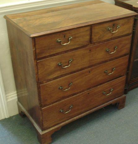A George III mahogany chest, the moulded rectangular top above two short and three long drawers, on bracket feet, 97cm.