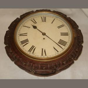 "A 19th Century wall clock, the 12"" painted dial with Roman chapter single fusee movement contained in scroll carved mahogany case, with pendulum."