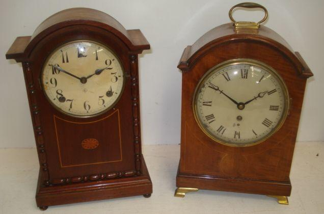 An Edwardian inlaid mahogany bracket style timepiece, 16cm silvered dial with brass carry handle and feet, 33cm, an inlaid mahogany mantle clock, the case decorated with split turnings, 36cm and a Victorian red marble and polished slate shaped mantle clock with visible pallett escapement. (3)