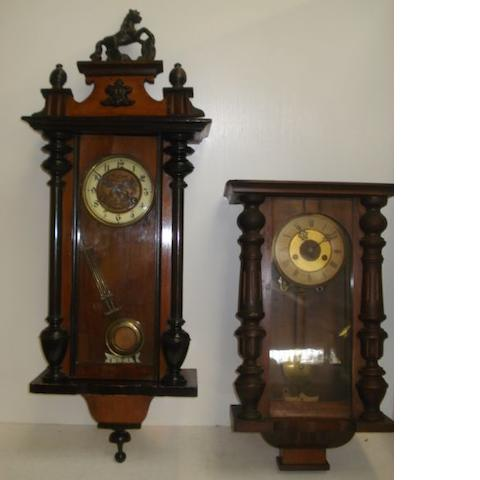 Two 19th Century Vienna style wall clocks, in walnut and ebonised cases. (2)