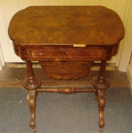 A Victorian inlaid walnut work table, with single drawer and pull-out well on turned and carved legs, 63cm.