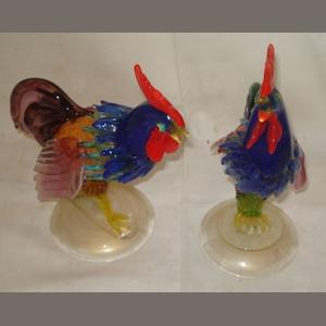 A pair of Venetian Murano glass cockerel figures, each multi coloured glass bird on a gold splashed base, 23 & 25cm.