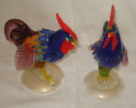 A pair of Venetian Murano glass cockerel figures, each multi coloured glass bird on a gold splashed base, 23 & 25cm.