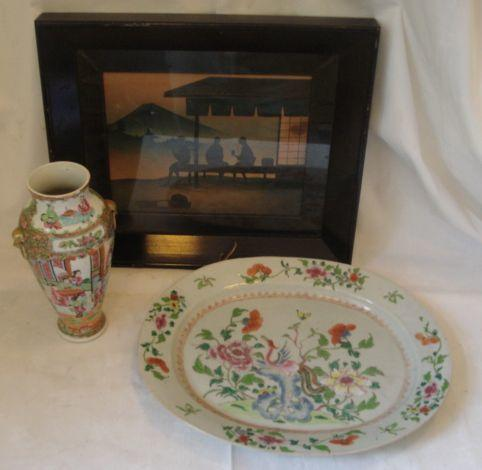A 19th Century Chinese Export serving plate, decorated in the famille rose palette with bird, peony and rock, 39 x 30cm, a Canton famille decorated vase, 25cm, and two framed Japanese pictures. (4)