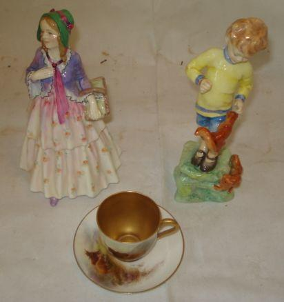 A Scarce Royal Doulton figure 'Clemency', HN 1633, 18cm, a Royal Worcester cabinet cup and saucer both painted with highland cattle, in highland landscape on a white ground the cup interior gilt signed 'H Stinton', date mark for 1918, and a figure after Freda Doughty, 'October', hand re-stuck. (4)