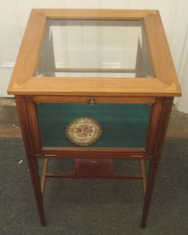 An Edwardian mahogany boxwood strung and inlaid curio cabinet, with bevelled glazed top and sides, on square tapered legs, 46.5cm.